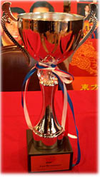 One of two award cups received by East Restaurant.